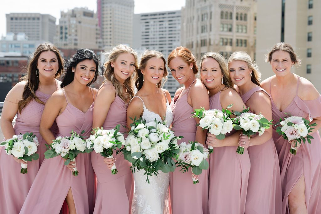 Bridesmaids in dusty rose with white bouquets - Classic and Neutral Wedding at the Garden Theater in Detroit, Michigan - Recap by wedding invitations designer Leah E. Moss Designs with photos by Niki Marie Photography