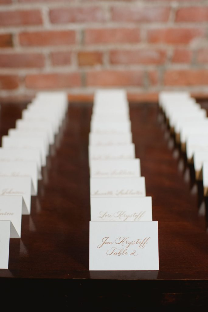 Escort cards in calligraphy - Classic and Neutral Wedding at the Garden Theater in Detroit, Michigan - Recap by wedding invitations designer Leah E. Moss Designs with photos by Niki Marie Photography