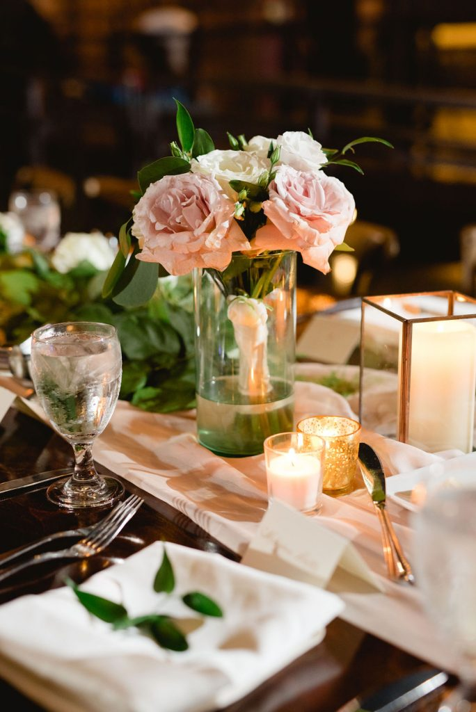 Neutral florals and candles with gold accents - Classic and Neutral Wedding at the Garden Theater in Detroit, Michigan - Recap by wedding invitations designer Leah E. Moss Designs with photos by Niki Marie Photography