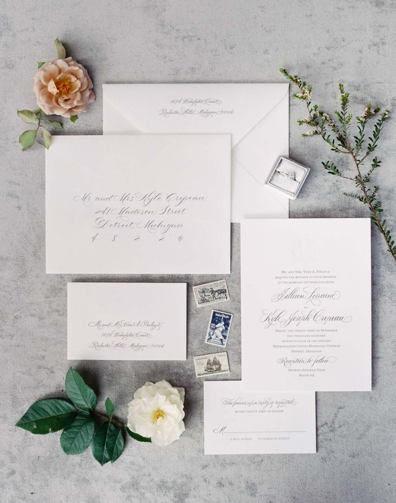 Grey letterpress wedding invitation with calligraphy - Traditional Detroit Athletic Club wedding - blog by Leah E. Moss Designs - photography by Blaine Siesser