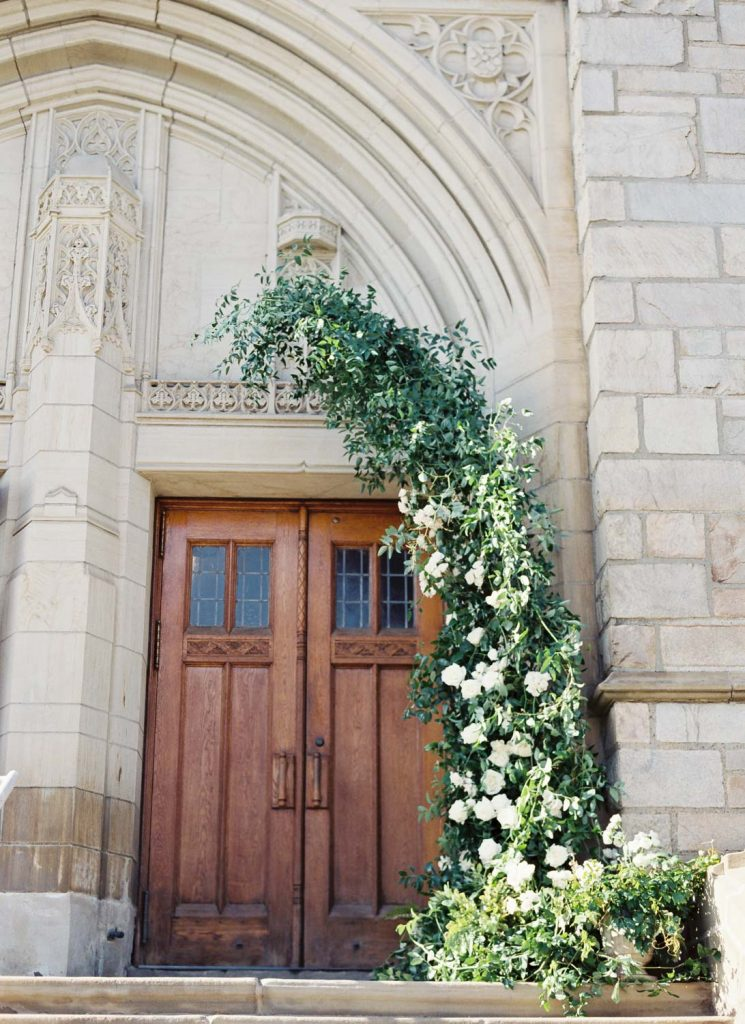 Church door with floral arch - Traditional Detroit Athletic Club wedding - blog by Leah E. Moss Designs - photography by Blaine Siesser
