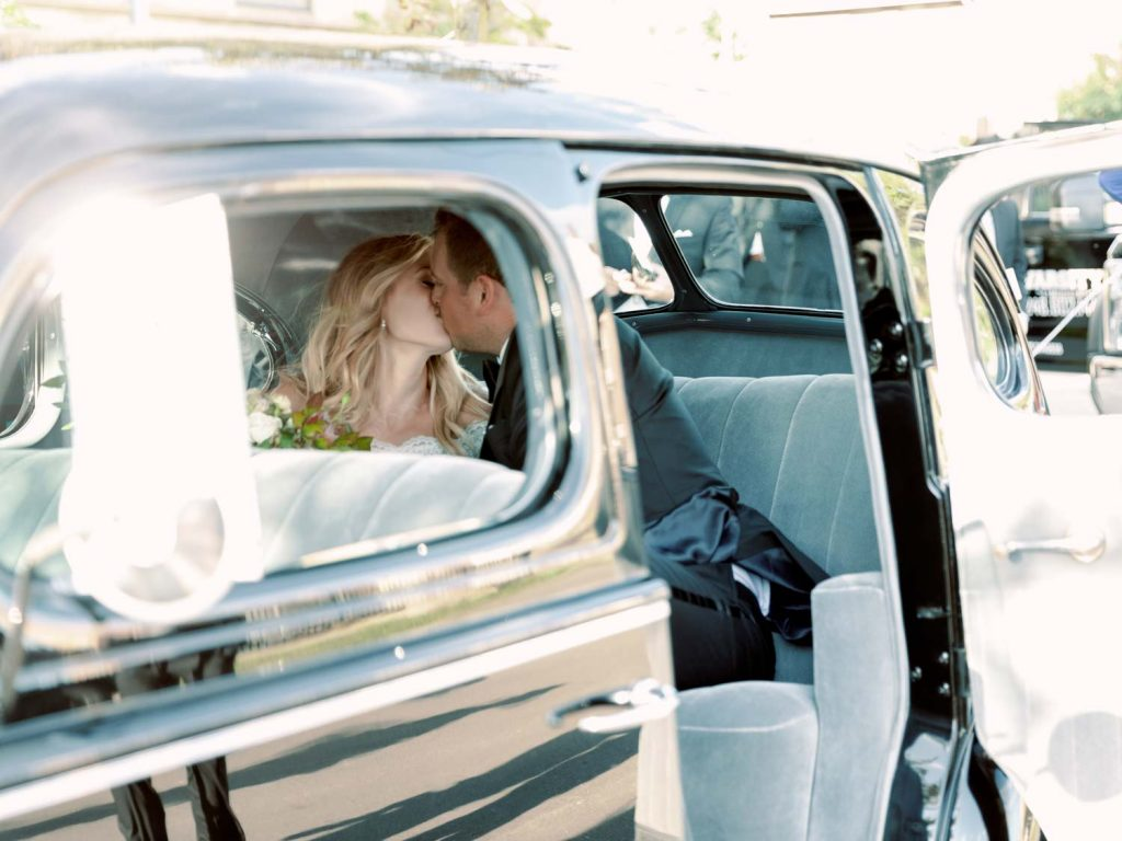 Classic car with bride and groom - Traditional Detroit Athletic Club wedding - blog by Leah E. Moss Designs - photography by Blaine Siesser