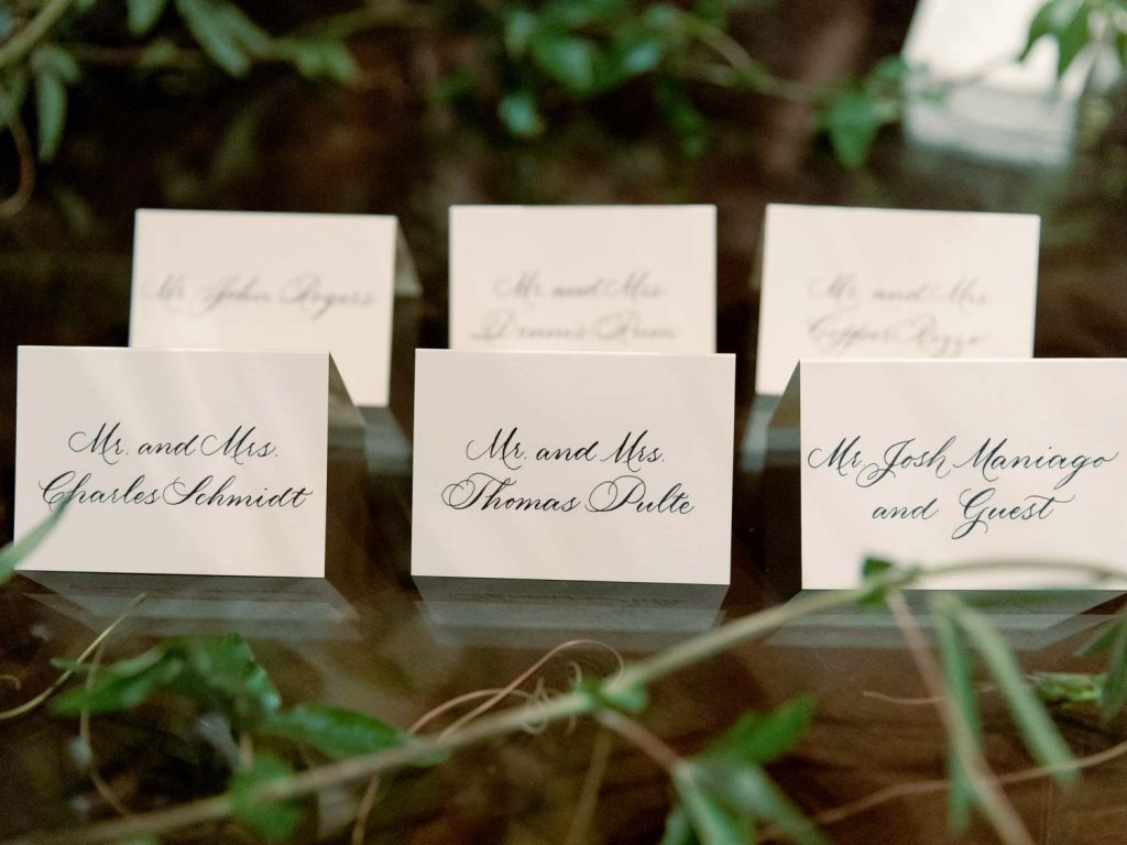 Escort cards in calligraphy - Traditional Detroit Athletic Club wedding - blog by Leah E. Moss Designs - photography by Blaine Siesser