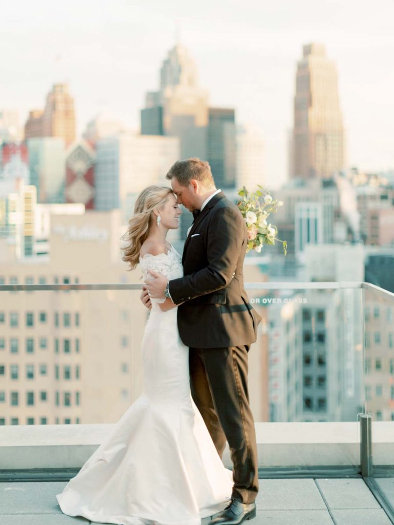 Bride and groom on Detroit rooftop - Traditional Detroit Athletic Club wedding - blog by Leah E. Moss Designs - photography by Blaine Siesser