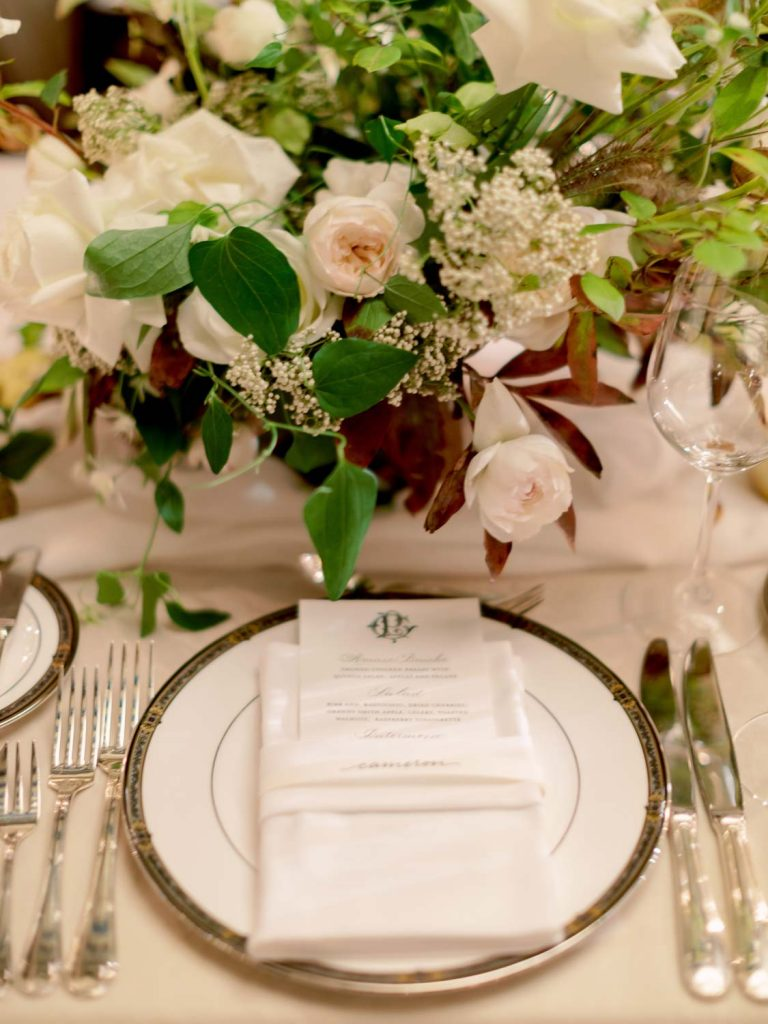Menu with charger plate and white and blush flowers - Traditional Detroit Athletic Club wedding - blog by Leah E. Moss Designs - photography by Blaine Siesser