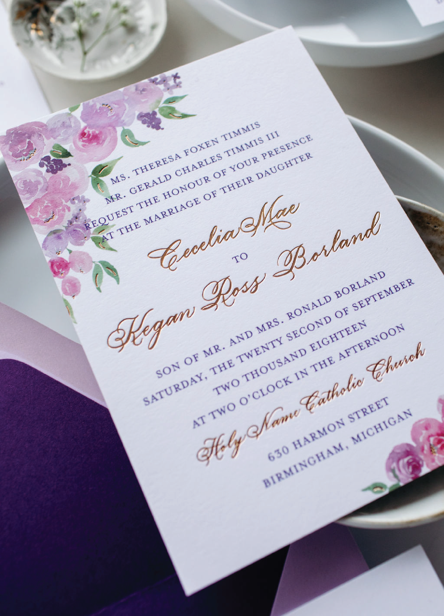 Pink and purple watercolor florals with rose gold foil and traditional script wedding invitations with calligraphy by Leah E. Moss Designs