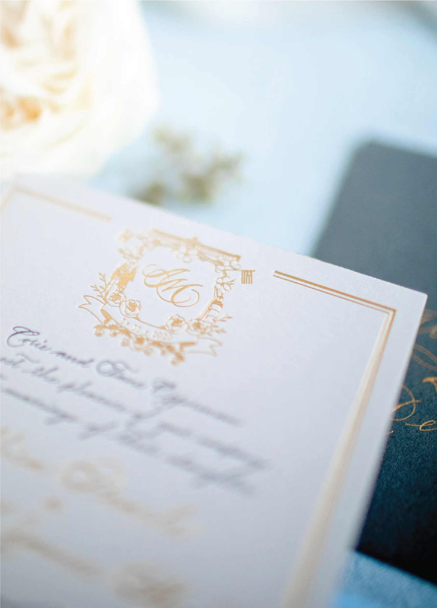 Custom crest in gold foil with all script wedding invitations with calligraphy by Leah E. Moss Designs
