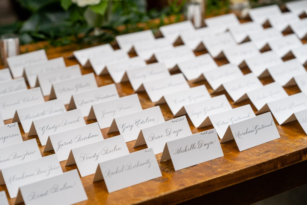 Hand calligraphed escort cards - Greenery-filled Planterra wedding - Leah E. Moss Designs