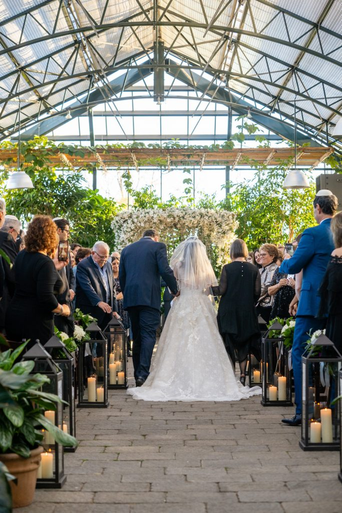Father of the bride walking her down the aisle - Greenery-filled Planterra wedding - Leah E. Moss Designs
