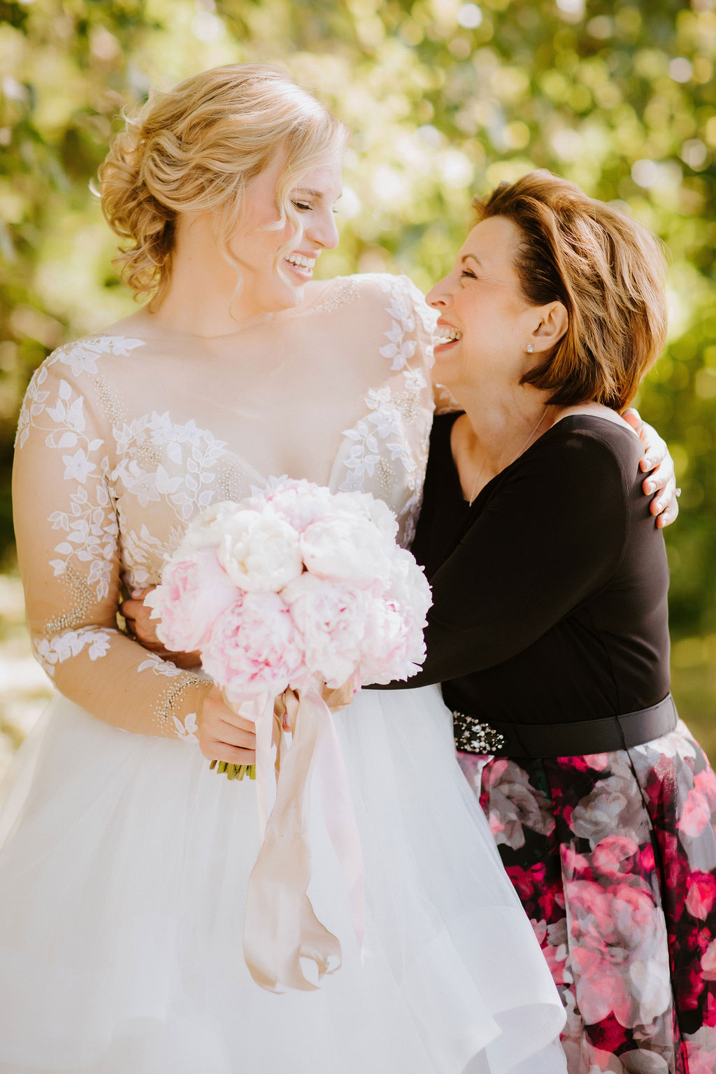 Bride with peonies bouquet laughing with mom, portrait photo by Abby Rose Photography - How mom can help with wedding planning - Leah E. Moss Designs