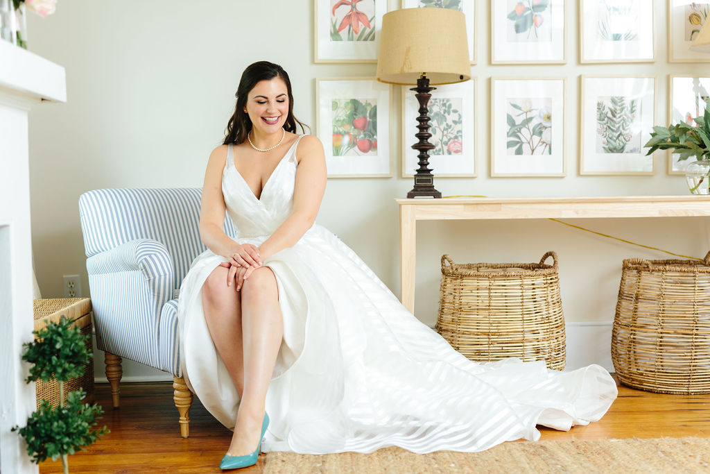 Bride in bright shoes with dress flowing to the side - Preppy spring wedding at Zingerman's Cornman Farms - Leah E. Moss Designs - photo by Katie Grace Photography