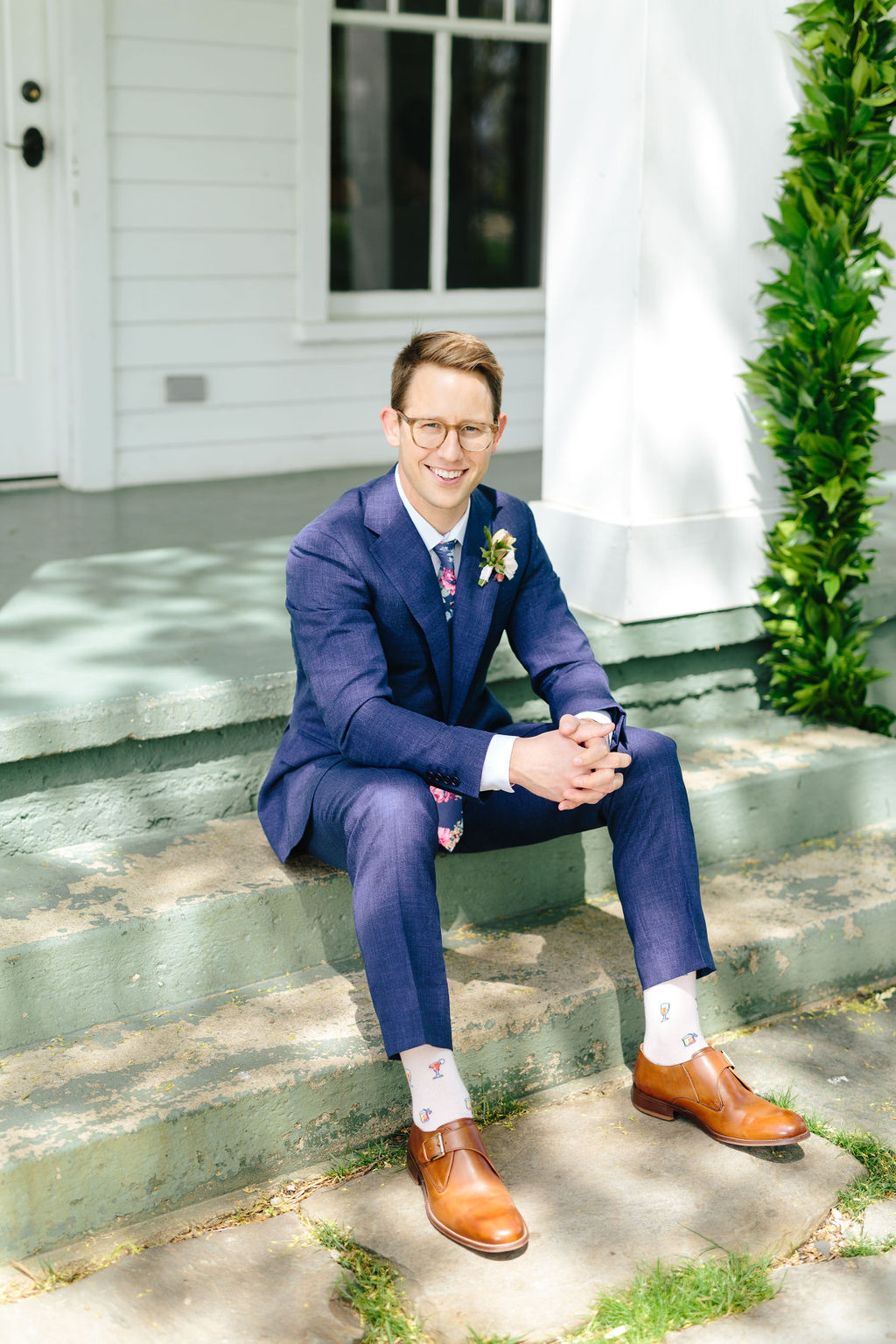 Groom in blue suit with floral tie - Preppy spring wedding at Zingerman's Cornman Farms - Leah E. Moss Designs - photo by Katie Grace Photography