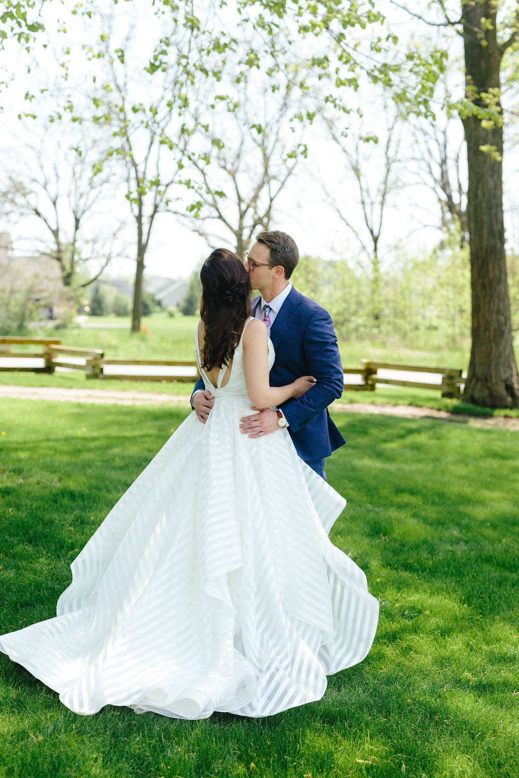 First look with a kiss on the cheek - Preppy spring wedding at Zingerman's Cornman Farms - Leah E. Moss Designs - photo by Katie Grace Photography