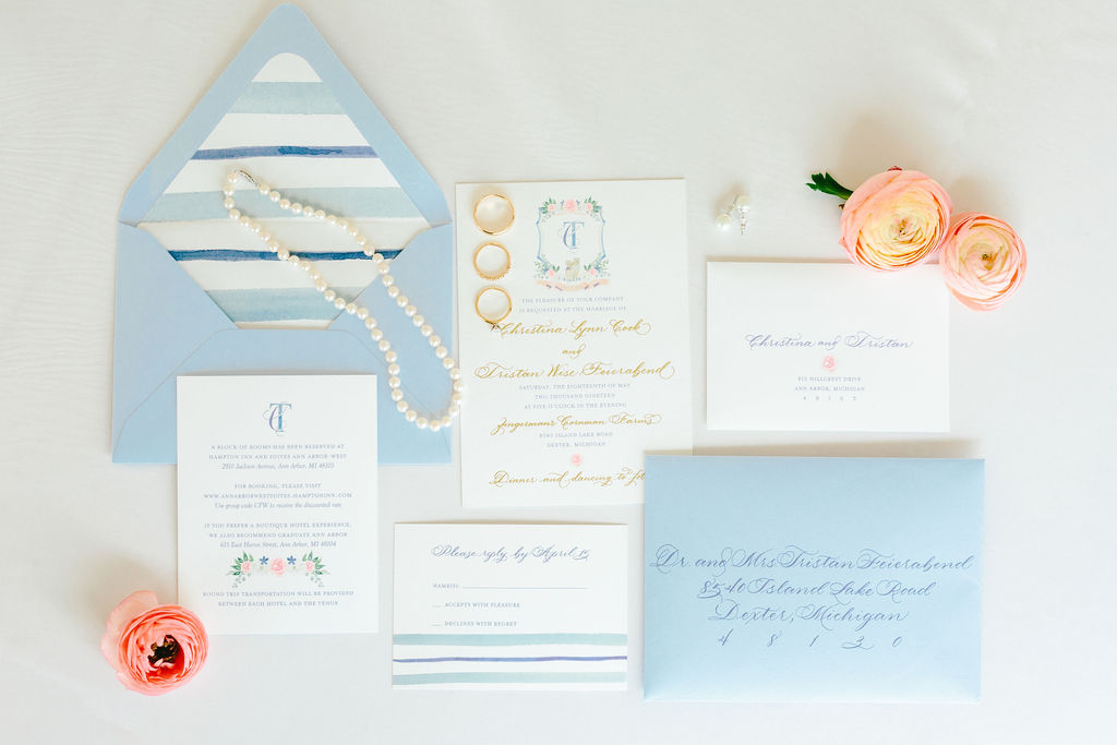 Invitation suite with watercolor crest, blue stripes, blue envelope, calligraphy envelopes - Preppy spring wedding at Zingerman's Cornman Farms - Leah E. Moss Designs - photo by Katie Grace Photography