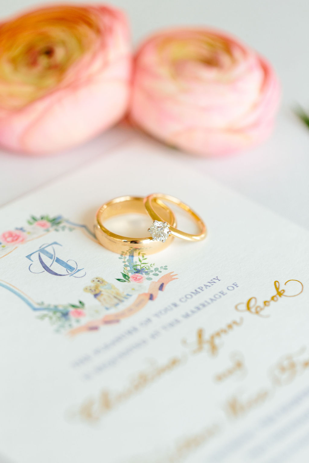 Rings on invitation with pink and blue watercolor crest - Preppy spring wedding at Zingerman's Cornman Farms - Leah E. Moss Designs - photo by Katie Grace Photography