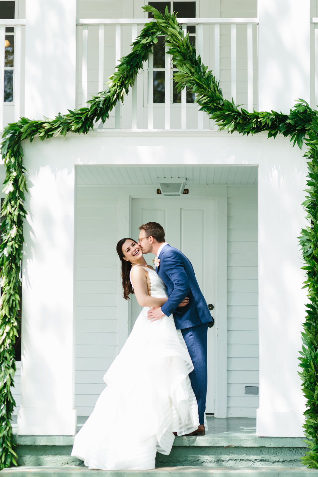 Kiss on the cheek for classic wedding portrait - Preppy spring wedding at Zingerman's Cornman Farms - Leah E. Moss Designs - photo by Katie Grace Photography