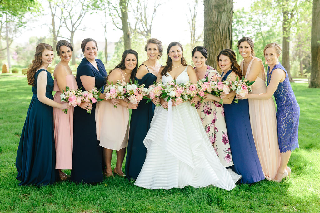 Mismatched bridesmaids with bouquets - Preppy spring wedding at Zingerman's Cornman Farms - Leah E. Moss Designs - photo by Katie Grace Photography