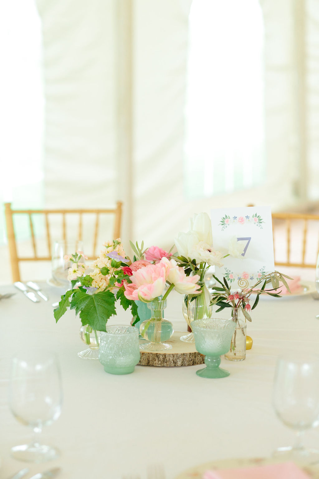 Natural floral arrangement with table number, designed to feature watercolor crest - Preppy spring wedding at Zingerman's Cornman Farms - Leah E. Moss Designs - photo by Katie Grace Photography