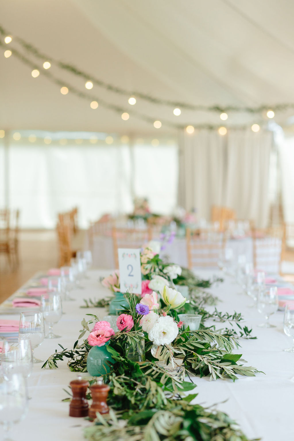 Garland of florals and greenery for long table centerpiece - Preppy spring wedding at Zingerman's Cornman Farms - Leah E. Moss Designs - photo by Katie Grace Photography