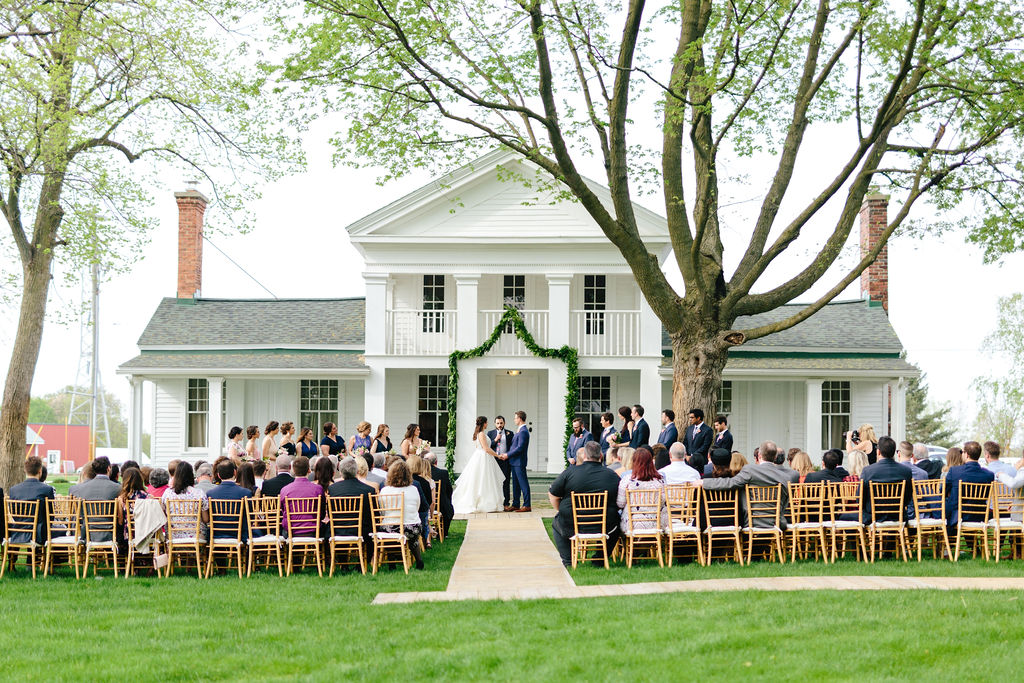 Farmhouse wedding outdoor ceremony - Preppy spring wedding at Zingerman's Cornman Farms - Leah E. Moss Designs - photo by Katie Grace Photography