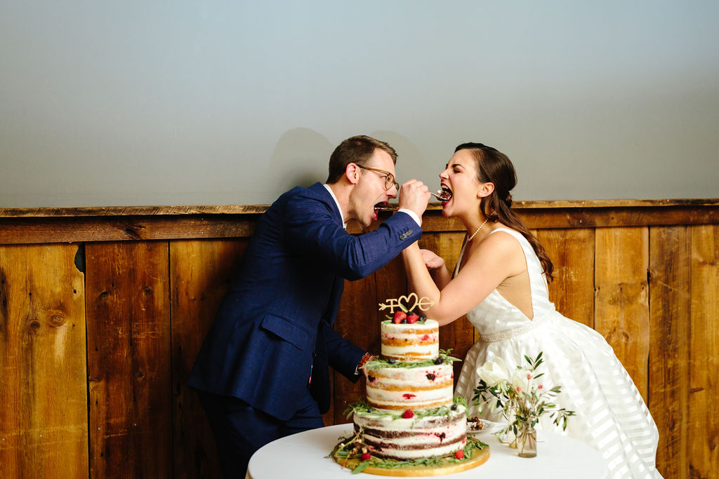 Bride and groom's cake cutting with naked cake - Preppy spring wedding at Zingerman's Cornman Farms - Leah E. Moss Designs - photo by Katie Grace Photography
