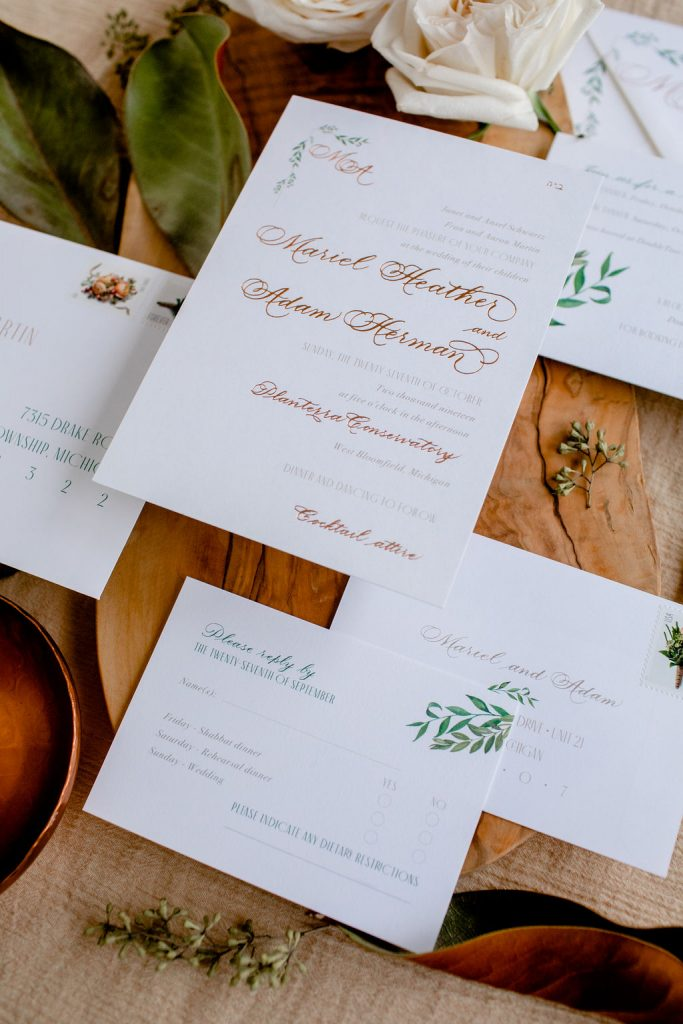 wedding stationery tips - USPS Stamps with greenery invitation - rose gold foil stamping - traditional calligraphy - art deco style - 3 types of wedding invitations postage - Leah E. Moss Designs