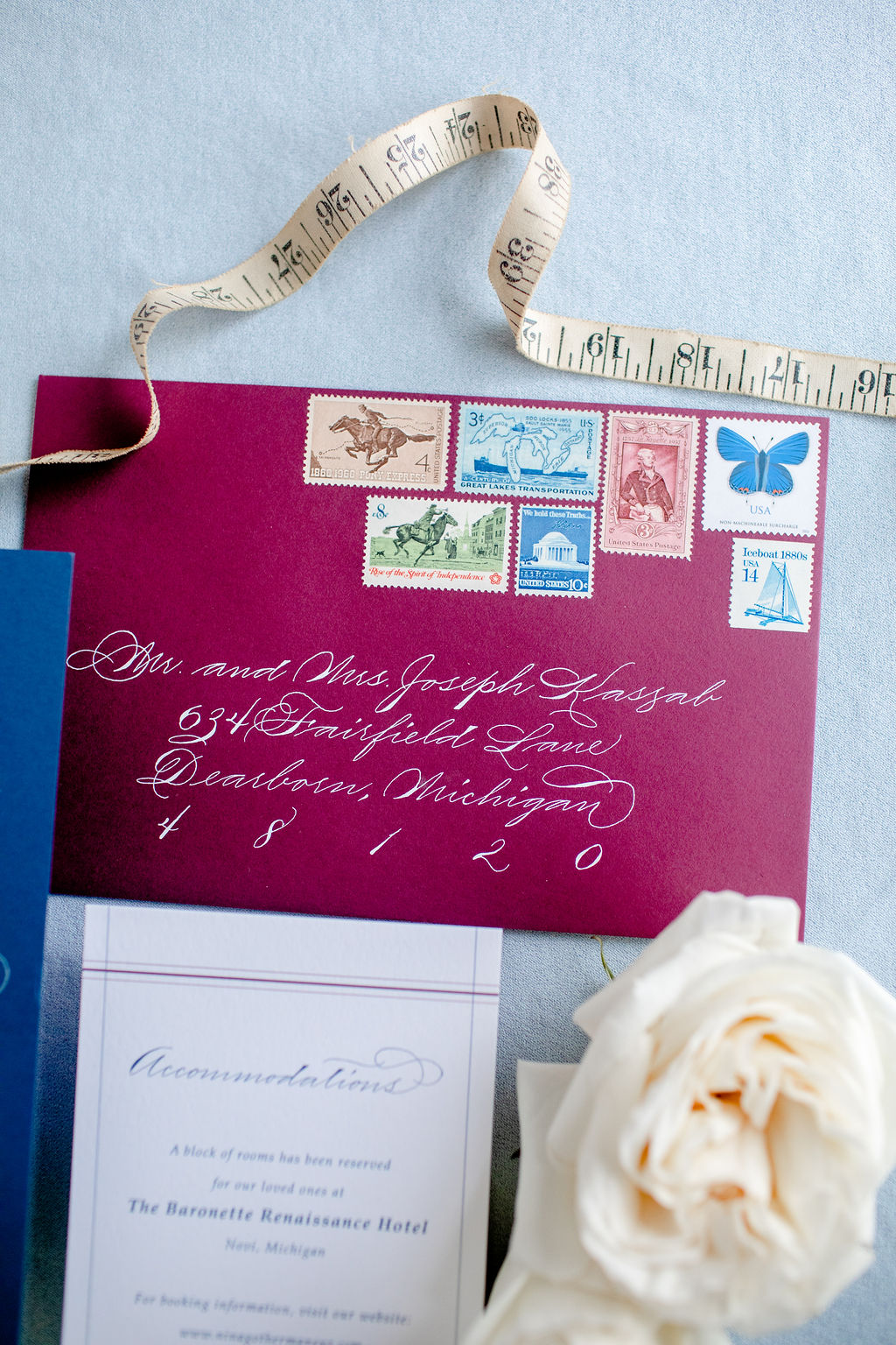 Vintage postage on burgundy envelope - white ink with calligraphy guest addresses - Spencerian traditional calligraphy style - 3 types of wedding invitations postage - Leah E. Moss Designs