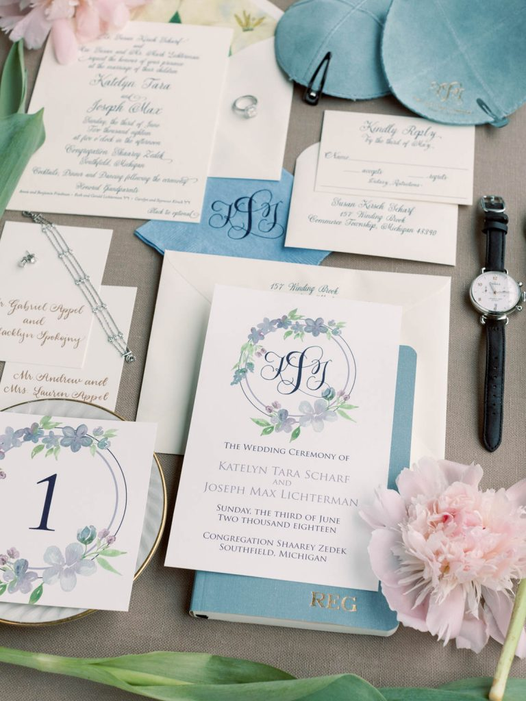 Ceremony program, table number, escort card, cocktail napkin, invitation suite all coordinated - Wedding stationery checklist - Leah E. Moss Designs - photo by Blaine Siesser