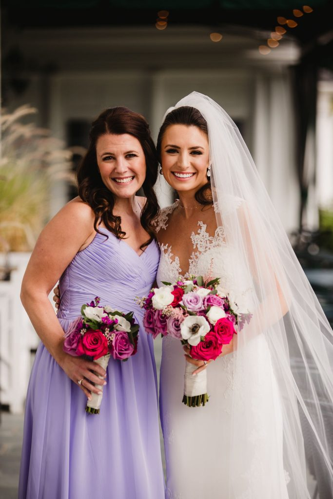 Bride and bridesmaid, lavender bridesmaid dress, lilac bridesmaid dress, spring wedding - How to use your wedding color palette in a different season - Leah E. Moss Designs - photo: Weddings by Adrienne & Amber