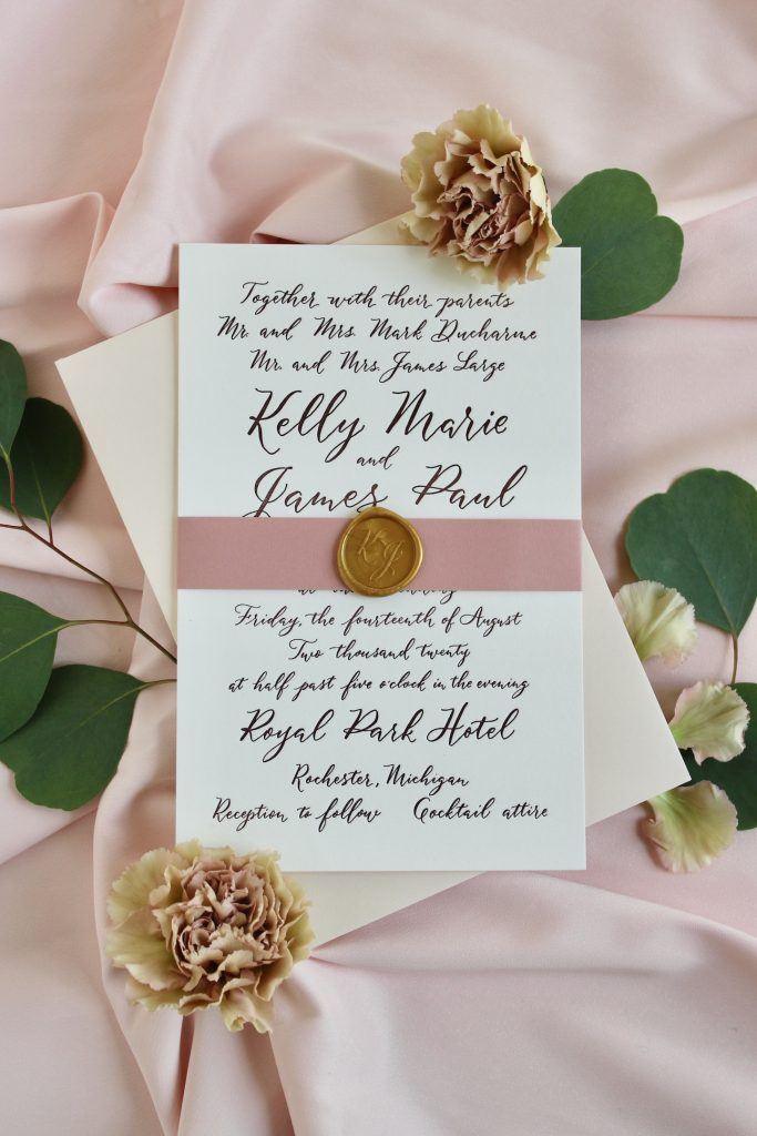 Burgundy semi-custom wedding invitation with modern calligraphy, dusty rose belly band, gold wax seal