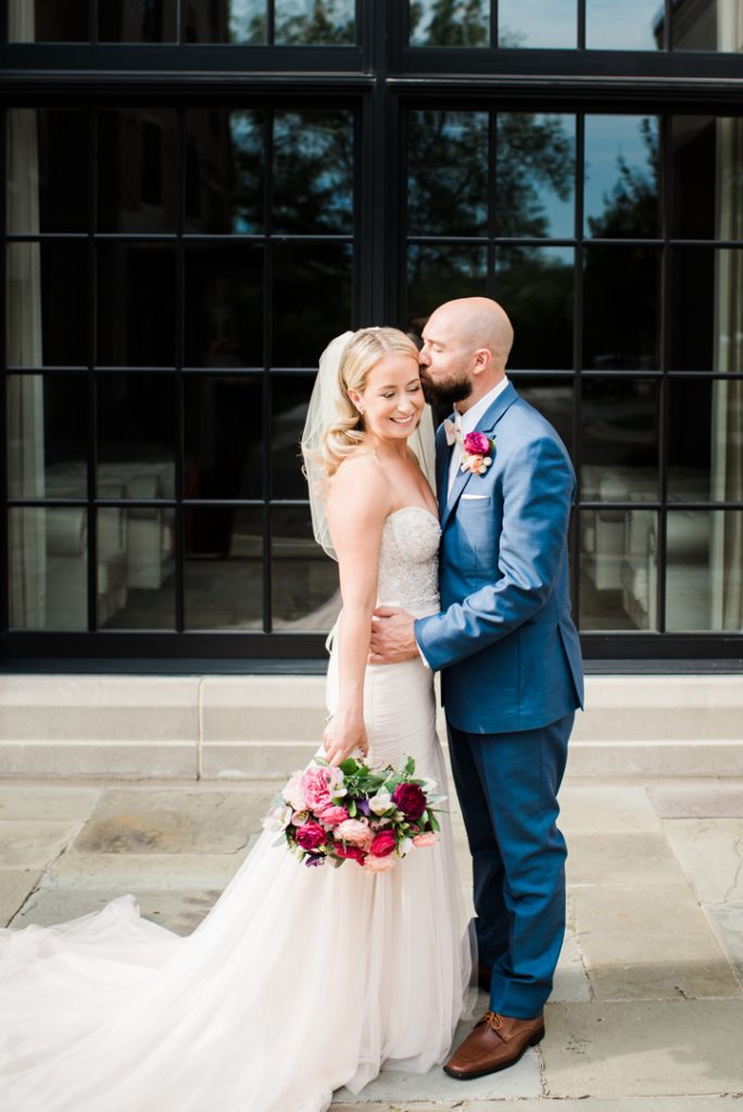 Wedding portrait, bride kissing groom, bride with bouquet, Rochester MI wedding - Royal Park Hotel wedding - Leah E. Moss Designs; photo by Brittany Emerson Photography