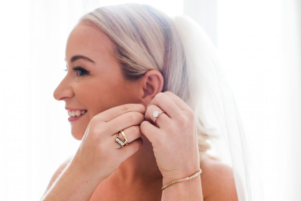 Bride putting earrings in, bride getting ready, bridal portrait, bridal details, wedding day detail shots - Royal Park Hotel wedding - Leah E. Moss Designs; photo by Brittany Emerson Photography
