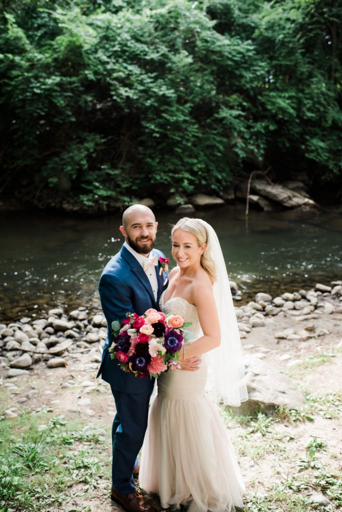 Wedding portrait near river, beautiful wedding portrait, outdoor wedding portrait, soft light wedding portrait, bride and groom, burgundy and pink wedding bouquet - Royal Park Hotel wedding - Leah E. Moss Designs; photo by Brittany Emerson Photography
