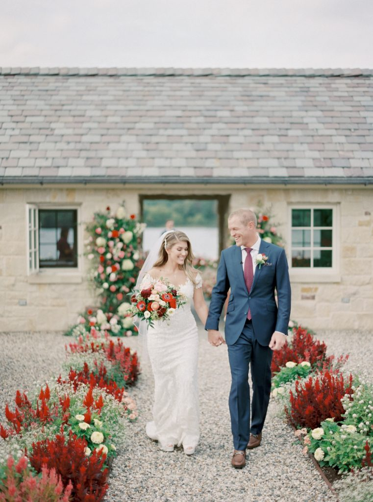 Flower-filled ceremony exit for bride and groom - Intimate wedding at home in Ann Arbor, Michigan - Leah E. Moss Designs - Photo by Blaine Siesser
