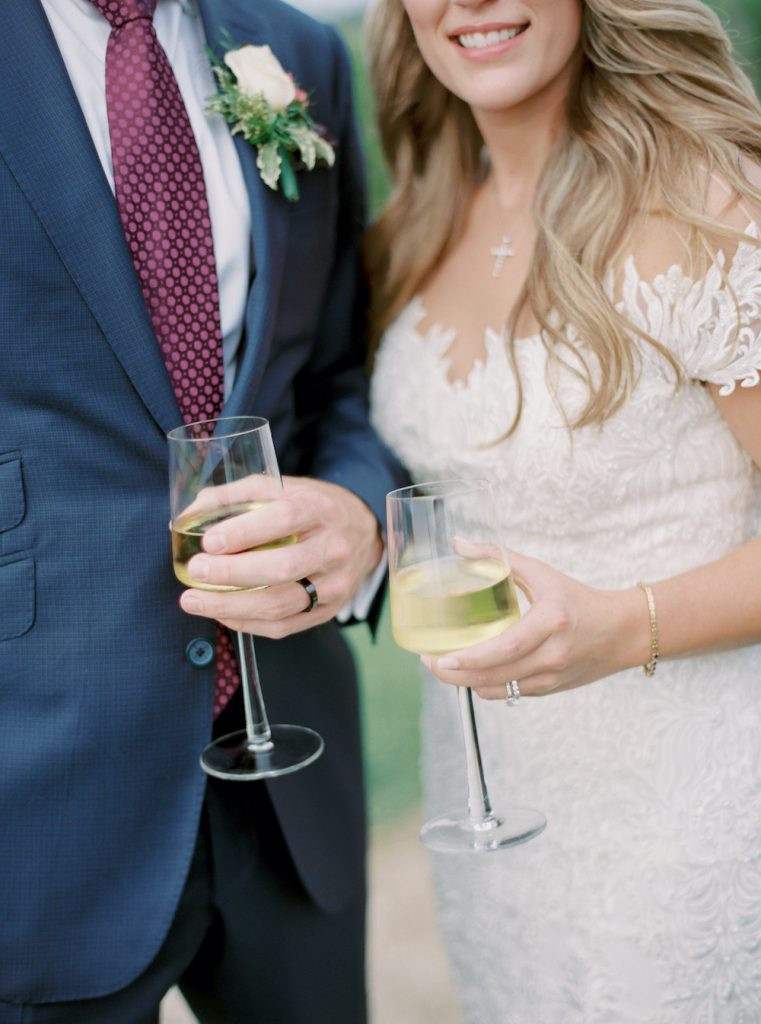 Bride and groom toasting - Intimate wedding at home in Ann Arbor, Michigan - Leah E. Moss Designs - Photo by Blaine Siesser