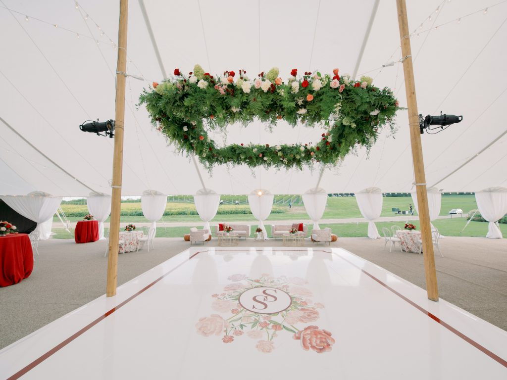 Floral installation and custom floral monogram dance floor emblem - Intimate wedding at home in Ann Arbor, Michigan - Leah E. Moss Designs - Photo by Blaine Siesser