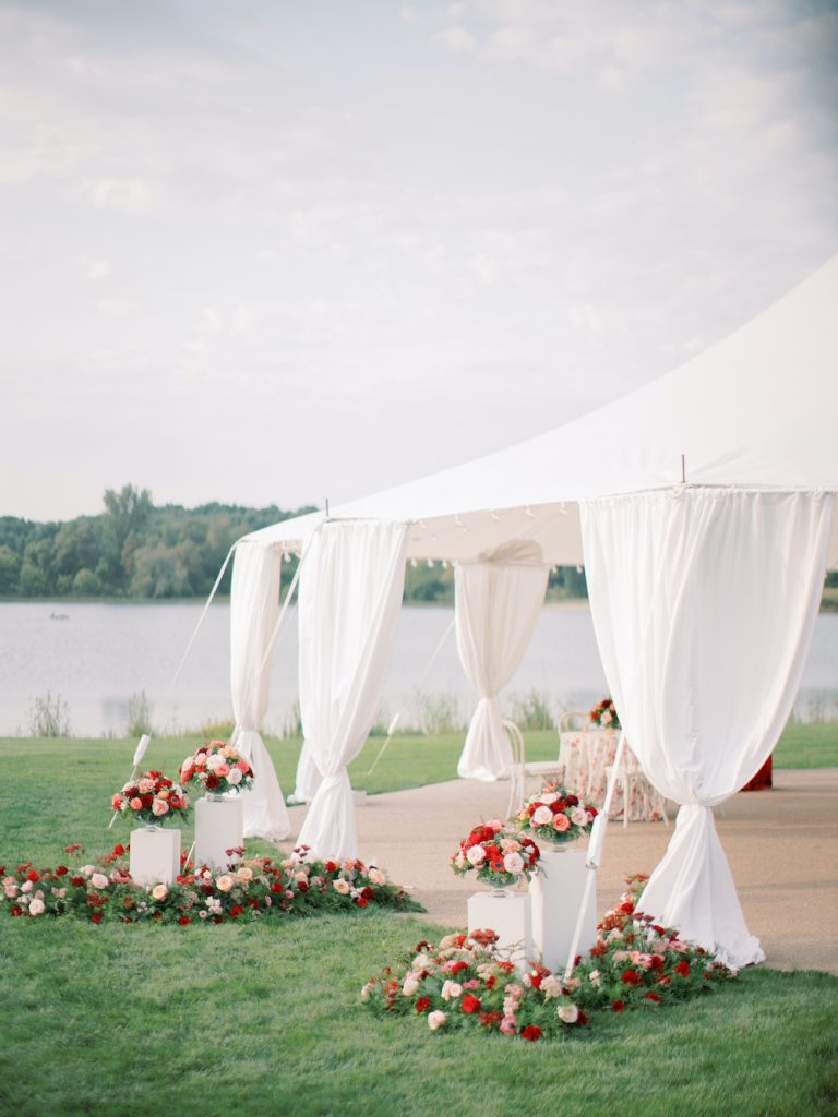 Sailtop tent with floral entrance - Intimate wedding at home in Ann Arbor, Michigan - Leah E. Moss Designs - Photo by Blaine Siesser