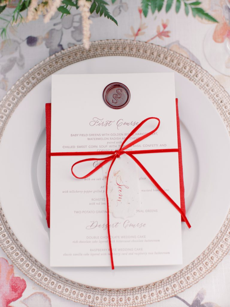 Letterpress menu with burgundy wax seal, hand calligraphed place card on seed paper, red velvet ribbon - Intimate wedding at home in Ann Arbor, Michigan - Leah E. Moss Designs - Photo by Blaine Siesser