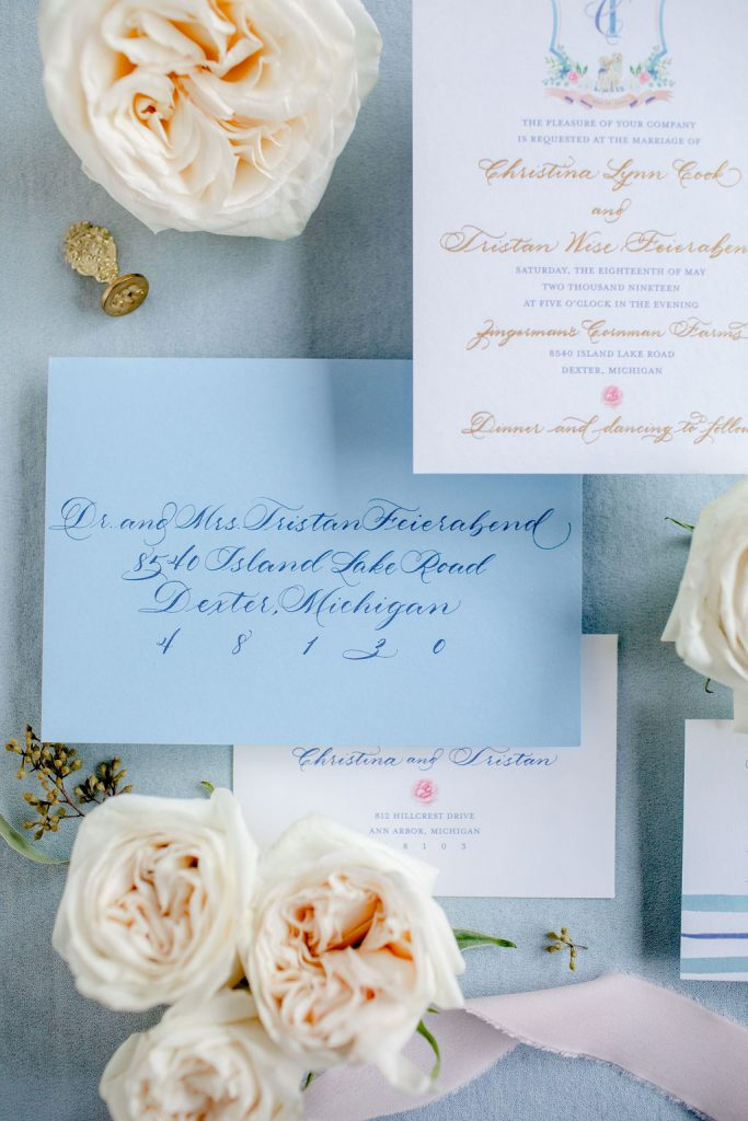 How to assemble wedding invitations - Leah E. Moss Designs, envelope calligraphy, blue invitation, luxury invitation, luxury wedding invitations, elegant wedding invitations, traditional wedding invitations, assembling invitations
