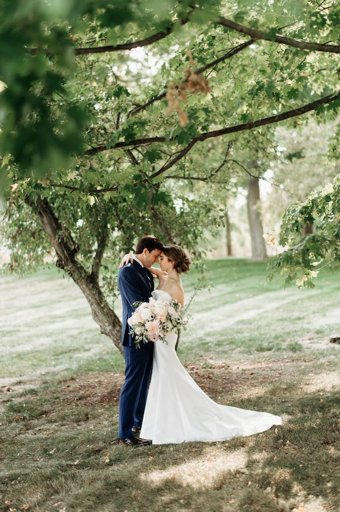 Farmhouse Chic Wedding - bride and groom under tree Leah E Moss