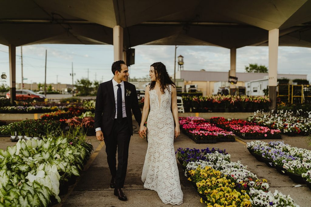 Bride and groom at flower patch - Eastern Market wedding recap from Detroit calligrapher Leah E. Moss Designs with photos by Jill DeVries Photography #detroitwedding #moderncalligraphy #custominvitation