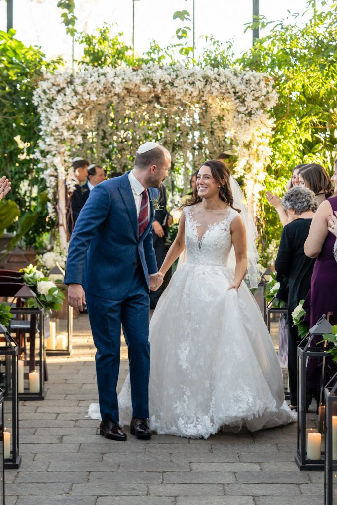 Bride and groom just married - Greenery-filled Planterra wedding - Leah E. Moss Designs