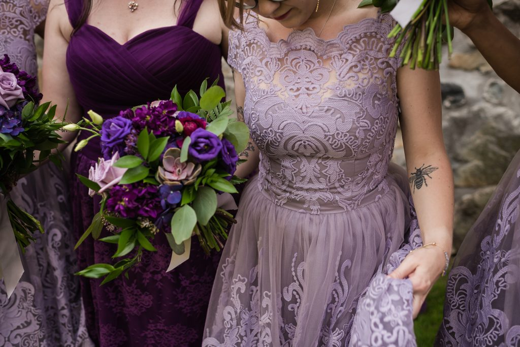 Lavender lace bridesmaid dress, purple wedding flowers - How to use your wedding color palette in a different season - Leah E. Moss Designs - photo: Chelsea Brown Photography