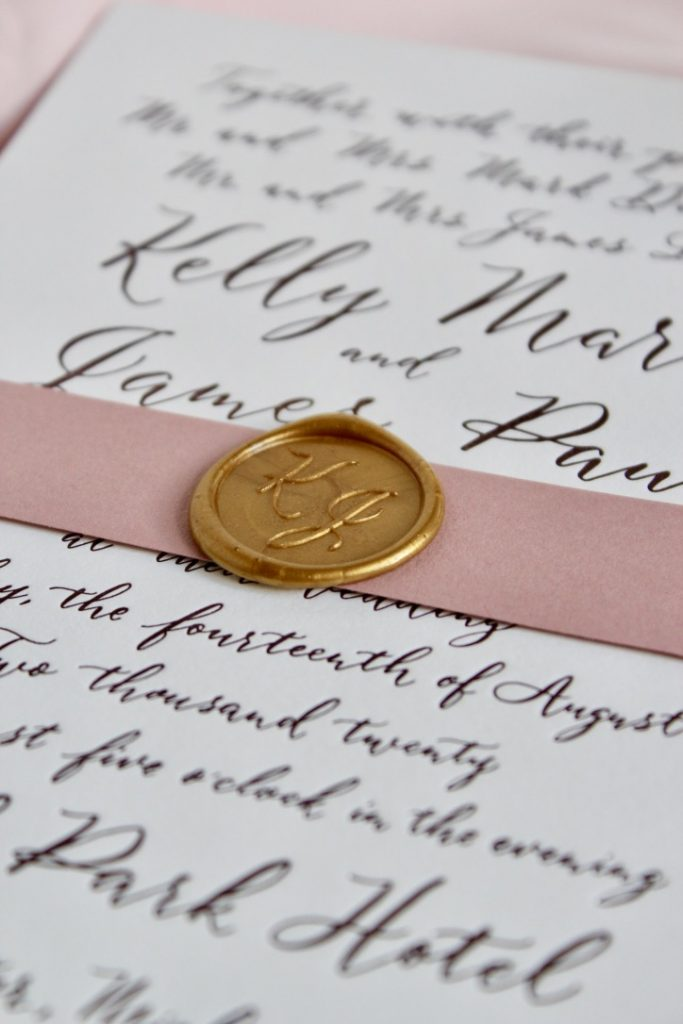 gold wax seal with dusty rose belly band from Leah E. Moss Designs