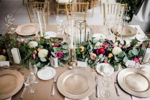 table setting with gold charger and taper candles