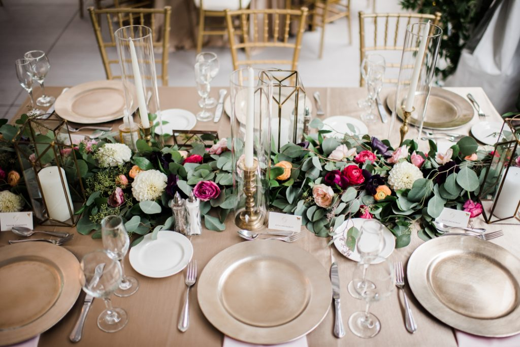 Garland on reception table with taper candles, elegant reception decor, escort card ideas, champagne linens, wedding reception decor - Royal Park Hotel wedding - Leah E. Moss Designs; photo by Brittany Emerson Photography