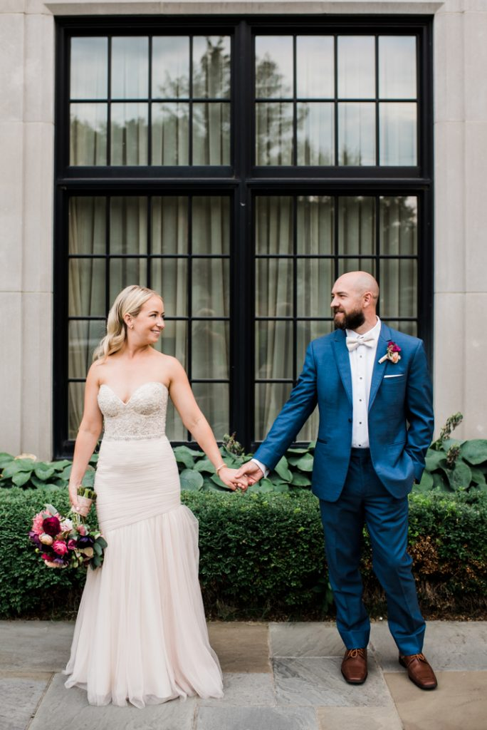 Couple holding hands, couple looking at each other, wedding day portrait - Royal Park Hotel wedding - Leah E. Moss Designs; photo by Brittany Emerson Photography