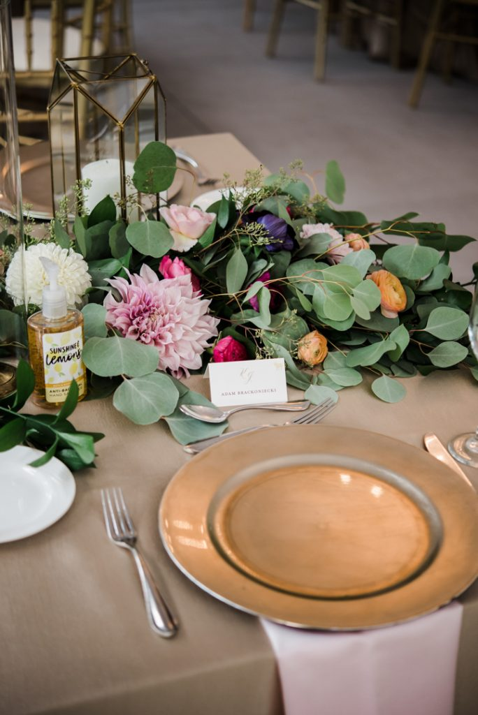 Table setting with escort card and charger plate, floral table runner, floral garland - Royal Park Hotel wedding - Leah E. Moss Designs; photo by Brittany Emerson Photography