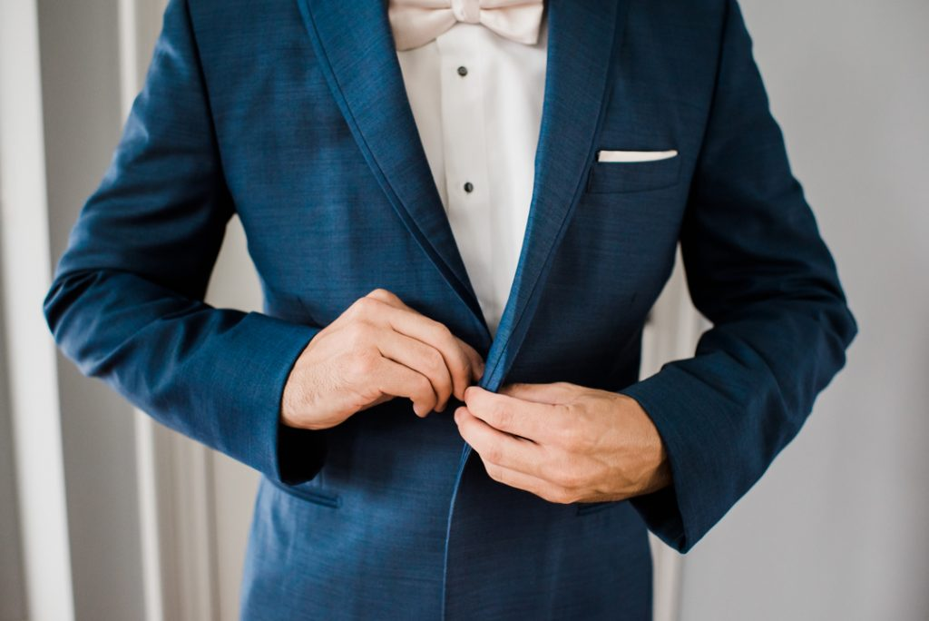 Blue suit and blush bow tie, well-dressed groom, groom suit, wedding suit, blue suit - Royal Park Hotel wedding - Leah E. Moss Designs; photo by Brittany Emerson Photography