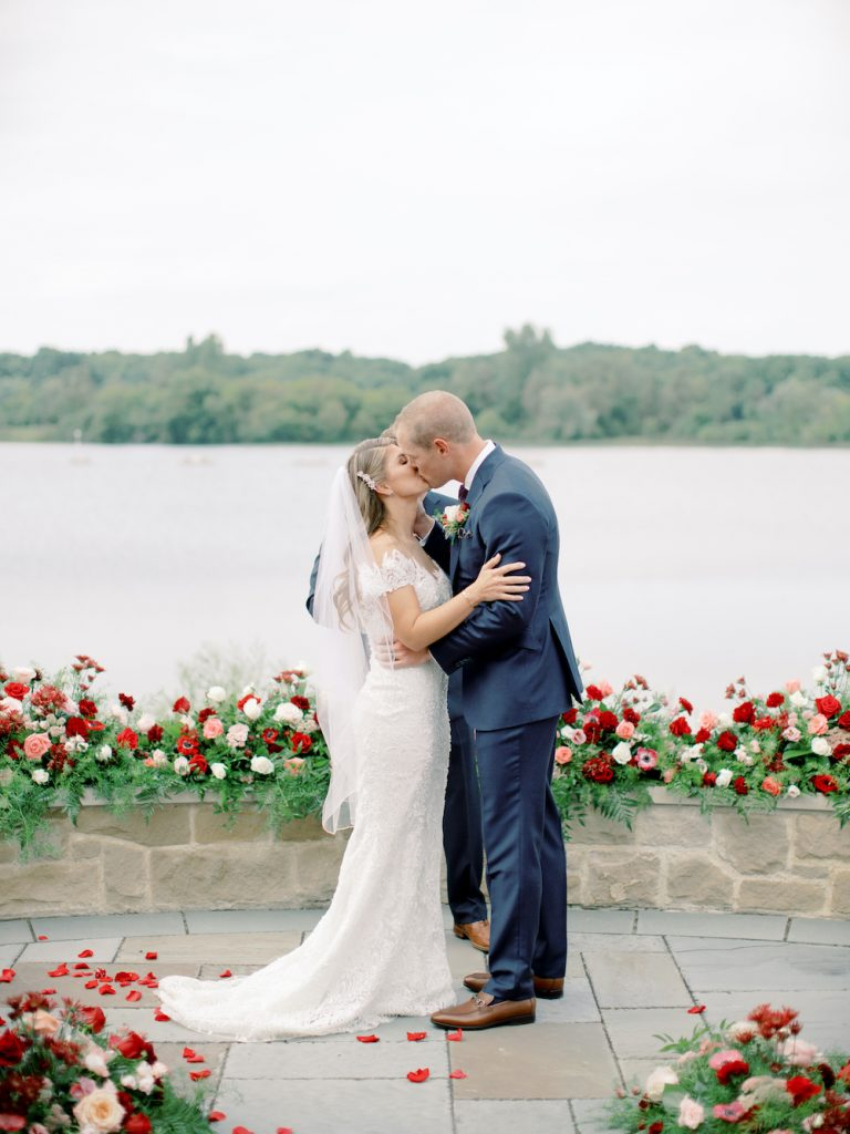 First kiss as husband and wife - Intimate wedding at home in Ann Arbor, Michigan - Leah E. Moss Designs - Photo by Blaine Siesser